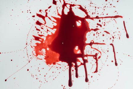 top view of flowing blood droplets on white surface