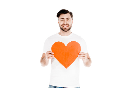Handsome smiling man showing red big heart shape sign isolated on white