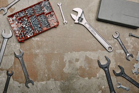 Top view of set of carpentry tools and box with screws on old surface Stock Photo