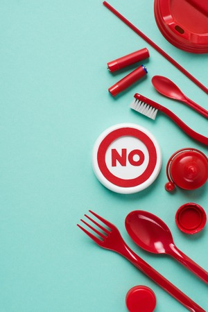 Top view of no sign and disposable plactic wares on blue background Stock Photo