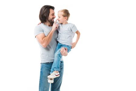Awesome father hugging, holding and ceressing his son isolated on white Stok Fotoğraf