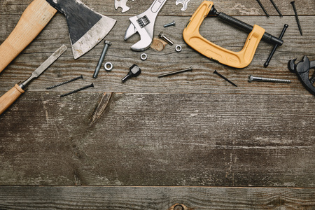 Top view of different carpentry tools on wooden background Stock Photo