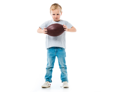 Little boy holding rugby ball isolated on white