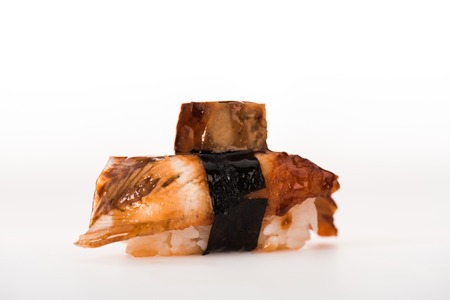 Delicious nigiri sushi with smoked eel isolated on white