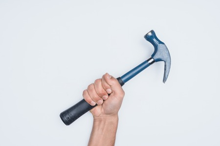 cropped shot of man holding hammer isolated on white Stock fotó
