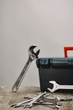 Close up of various tools on wooden table on grey background Banco de Imagens
