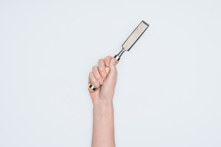 cropped shot of woman holding chisel isolated on white Stock fotó