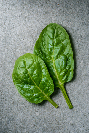 top view of wet spinach leaves with water drops Stock Photo