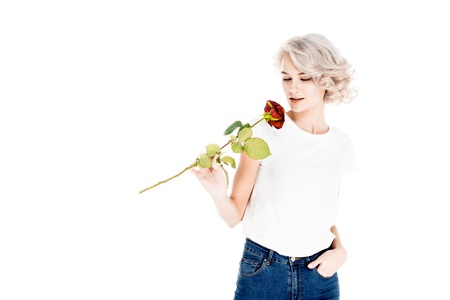 Wonderful young adult woman smelling red rose isolated on white Stock Photo