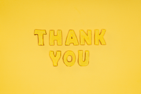thank you lettering in cookies isolated on yellow background