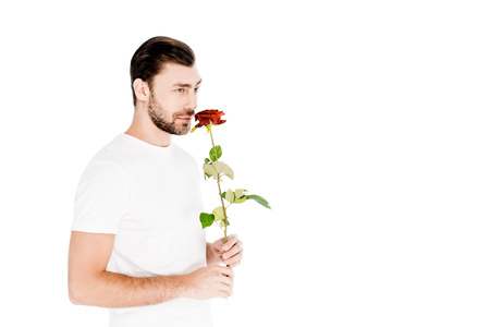 Handsome man smelling red rose isolated on white Stock Photo