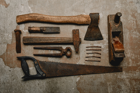 Top view of various rusty carpentry tools on old background Stock Photo