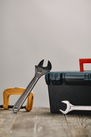 Close up of various tools on wooden table on grey background Stock Photo