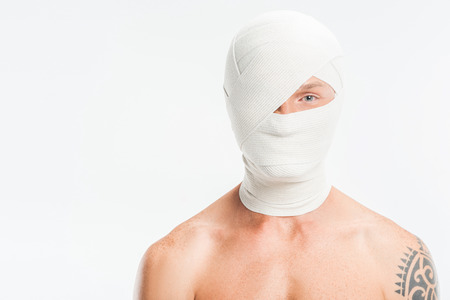 close up of nude man with bandages over head after plastic surgery isolated on white
