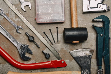 Flat lay with set of tools and smartphone on wooden background Stock Photo