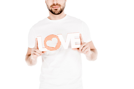 Partial view of man holding love sign isolated on white