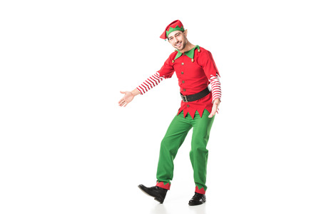happy man in christmas elf costume with outstreched hands isolated on white