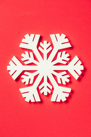 top view of paper snowflake on red background Stock Photo