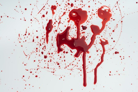 close-up shot of messy blood splashes on white tabletop