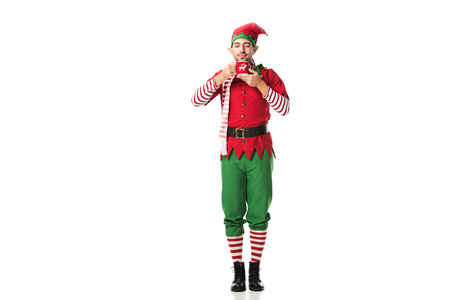 man in christmas elf costume with eyes closed holding cup of tea and inhaling aroma isolated on white 版權商用圖片