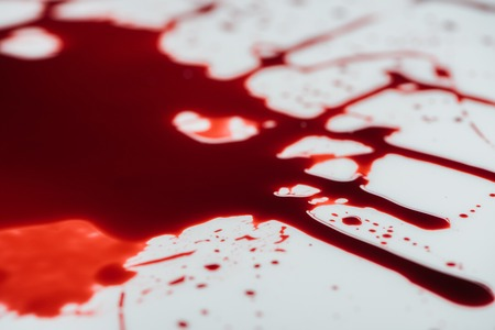 close-up shot of blood droplets on white surface