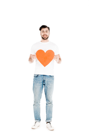Handsome man showing red big heart shape sign isolated on white Standard-Bild - 112385433