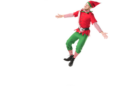 happy man in christmas elf costume jumping isolated on white background Stock Photo
