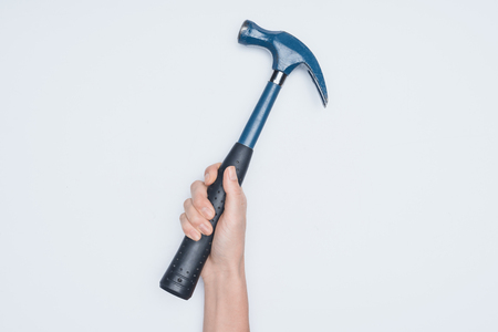 cropped shot of woman holding hammer isolated on white Standard-Bild
