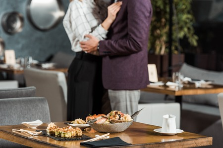 Cropped view of hugging dancing couple in restaurant Imagens