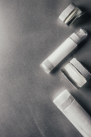view from above of beauty cream and lotion on silver Stock Photo