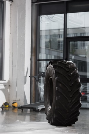 one black tire for workout in gym