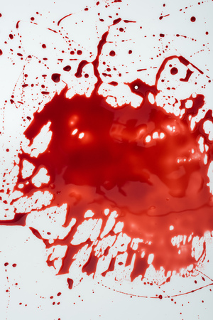 top view of messy blood blot on white