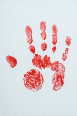 top view of blood print made with hand on white Stock Photo