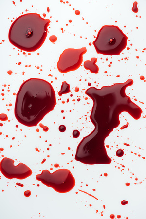 top view of messy blood droplets on white tabletop