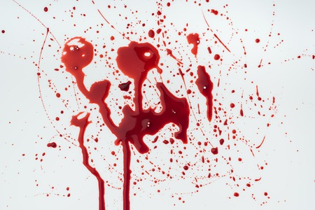 close-up shot of messy blood droplets on white