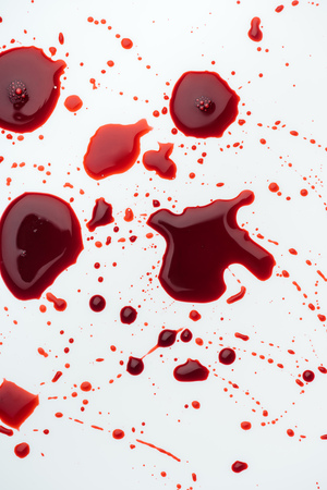 top view of messy blood droplets on white surface
