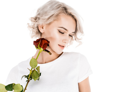Attractive  woman holding red flower isolated on white Standard-Bild - 112386491