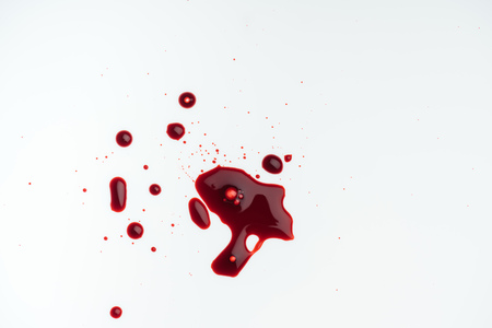 top view of white tabletop with blood blots