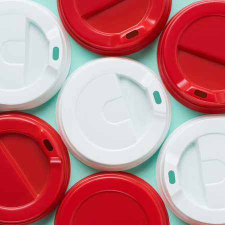 Close up view of red and white lids for drink on blue backgroun Stock Photo
