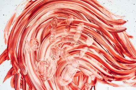 top view of smeared blood with hand print on white surface Stock Photo