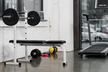 treadmill, barbell and weights in modern gym 스톡 콘텐츠