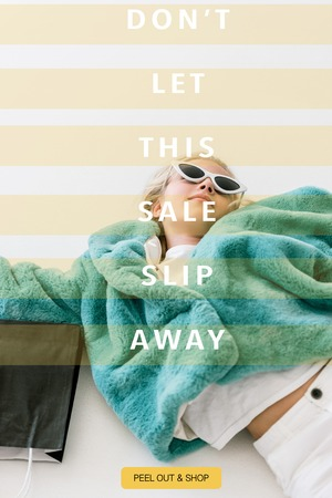 beautiful stylish child in turquoise fur coat lying with black shopping bag on white, dont let this sale slip away inscription Stock Photo