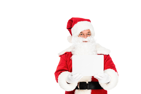 santa claus holding laptop and looking at camera isolated on white