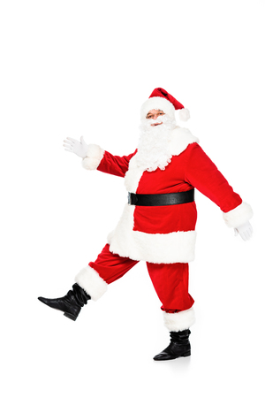 side view of santa claus walking and looking at camera isolated on white Banco de Imagens