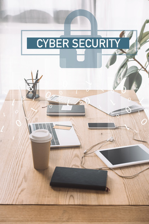 close up view of cuber security sign, workplace with laptop, coffee to go and notebook