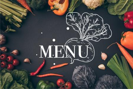 top view of ripe vegetables on gray table, menu lettering Stock fotó