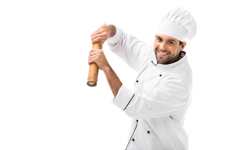 happy young chef with bamboo pepper mill isolated on white Stock Photo - 112247700