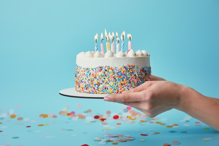 Partial View Of Woman Holding Birthday Cake With Candles On Blue Background Confetti Standard