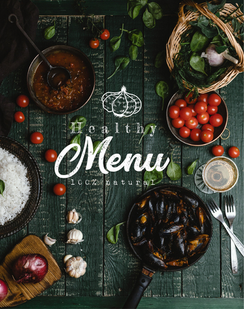 Top view of cooked mussels with shells served in pan with tomatoes, herbs and wine on wooden table, healthy menu lettering