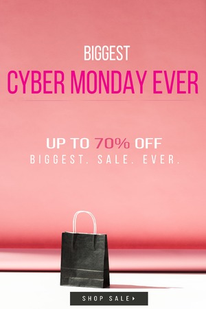 one black shopping bag on pink with copy space, cyber monday sale banner concept Stock Photo